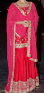 Bride wearing pink glitzy embroidery sharara