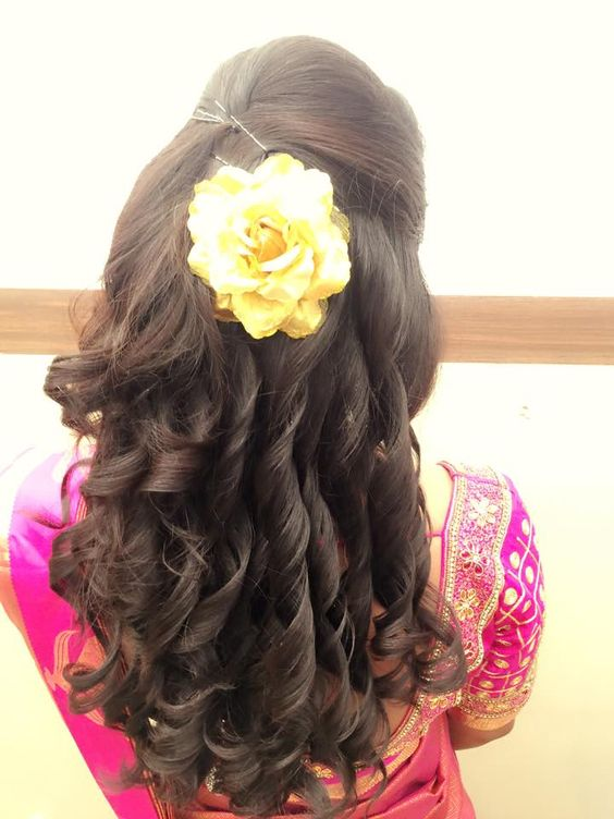 hairstyle for Mehndi with big flower